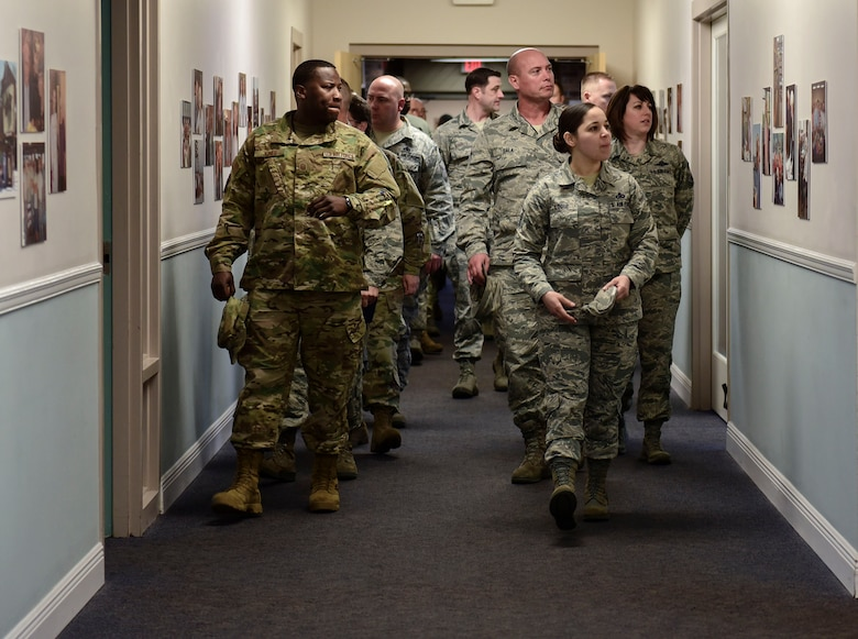 Airmen tour a facility at the Air Force Enlisted Village as part of the installation's first Superintendent Symposium Jan. 27 at Eglin Air Force Base, Fla. The nearly week-long course was established to fulfill a gap in training for superintendents. Students learned about their daily roles, how to support of the overall health of their squadron and prepare for the unexpected. The curriculum also included briefings by subject matter experts on deployment and medical readiness, manpower, budget, assignments, inspector general applications, and personnel. (U.S. Air Force Photo/Jasmine Porterfield)
