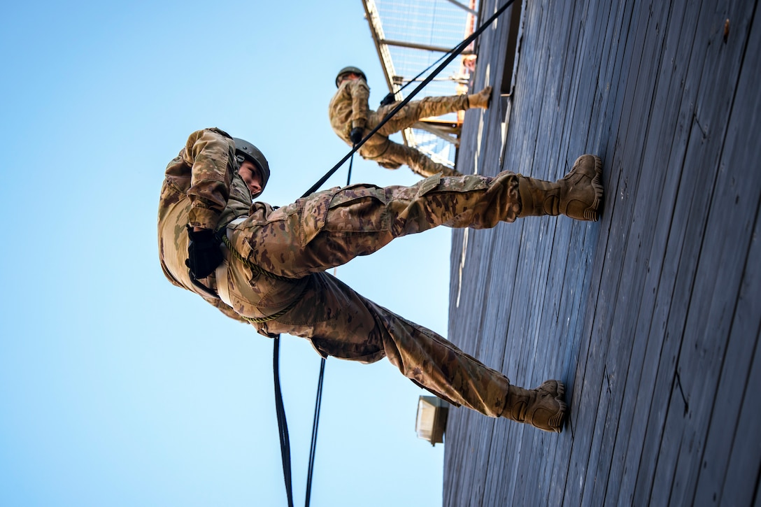 Airmen perform the brake technique prior to rappelling down the Safe Rappel Tower during an Army Air Assault Assessment, Jan. 28, 2019, at Moody Air Force Base, Ga. Airmen demonstrated their comprehensive rappel tower knowledge to help determine their overall readiness for Army Air Assault school (U.S. Air Force photo by Airman First Class Eugene Oliver)