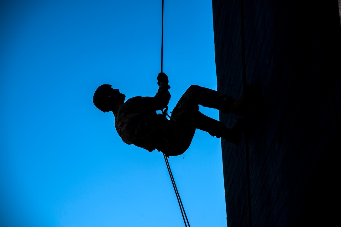 An Airman prepares to rappel down the Safeside Rappel Tower during an Army Air Assault Assessment (AAA), Jan. 28, 2019, at Moody Air Force Base, Ga. The AAA is designed to determine Airmen's physical and mental readiness before being able to attend Army Air Assault school. (U.S. Air Force photo by Airman First Class Eugene Oliver)