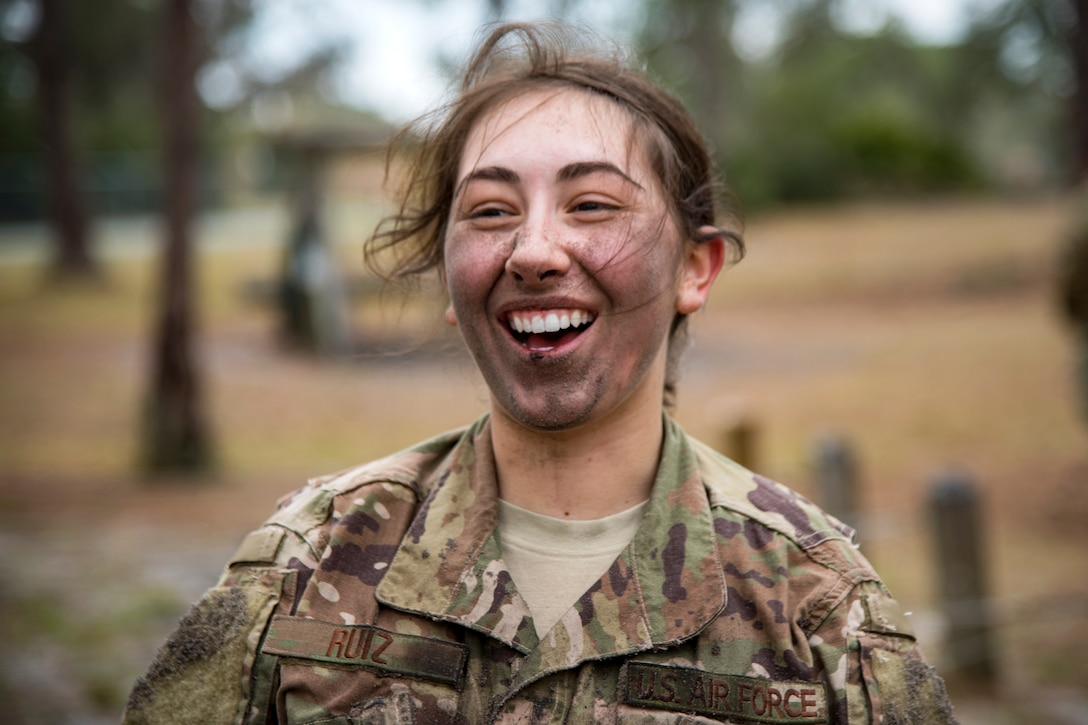 Airman First Class Madison Ruiz, 823d Base Defense Squadron security forces member, smiles after finishing the last obstacle during an Army Air Assault Assessment, Jan 30, 2019, at Camp Blanding, Fla. Throughout the assessment, cadres challenged Airmen's physical and mental limits to determine who would be selected prior to attending Army Air Assault School. (U.S. Air Force photo by Airman First Class Eugene Oliver)