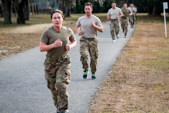 Airmen run the 2-mile portion of the Army Physical Fitness test as part of an Army Air Assault Assessment, Jan. 30, 2019, at Camp Blanding, Fla. Throughout the assessment, cadres challenged Airmen's physical and mental limits to determine who would be selected prior to attending Army Air Assault School. (U.S. Air Force photo by Airman First Class Eugene Oliver)