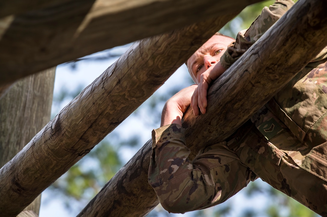 Airman 1st Class Kasey Dybas, 822d Base Defense Squadron fireteam member, navigates through the weaver obstacle during an Army Air Assault Assessment (AAA), Jan. 30, 2019, at Camp Blanding, Fla. The AAA is designed to determine Airmen's physical and mental readiness before being selected to attend Army Air Assault school. (U.S. Air Force photo by Airman First Class Eugene Oliver)