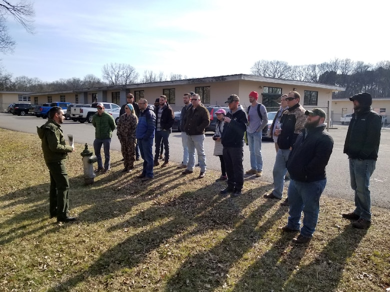 Park Ranger Ben MacIntyre (Left) leads an invasive species field exercise at J. Percy Priest Lake in Nashville, Tenn., Jan. 31, 2019 during a class for U.S. Army Corps of Engineers employees that focuses on environmental stewardship. (USACE photo)