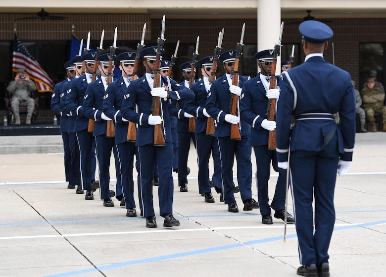 The U.S. Air Force Honor Guard Drill Team debuts their 2019 routine in front of Keesler leadership and 81st Training Group Airmen on the Levitow Training Support Facility drill pad at Keesler Air Force Base, Mississippi, Feb. 8, 2019. They are the nation's most elite honor guard, serving the President of the United States, the Air Force's most senior leaders and performing nationwide for the American public. The team comes to Keesler every year for five weeks to develop a new routine that they will use throughout the year. (U.S. Air Force photo by Kemberly Groue)