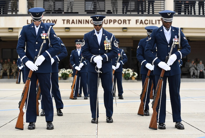 The U.S. Air Force Honor Guard Drill Team debuts their 2019 routine in front of Keesler leadership and 81st Training Group Airmen on the Levitow Training Support Facility drill pad at Keesler Air Force Base, Mississippi, Feb. 8, 2019. The team comes to Keesler every year for five weeks to develop a new routine that they will use throughout the year. (U.S. Air Force photo by Kemberly Groue)