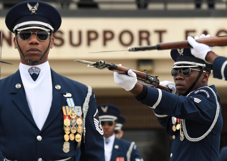U.S. Air Force Master Sgt. Jason Prophet, U.S. Air Force Honor Guard Drill Team superintendent, and Senior Airman Colby Marshall, U.S. Air Force Honor Guard Drill Team member, participate in the debut performance of the team's 2019 routine in front of Keesler leadership and 81st Training Group Airmen on the Levitow Training Support Facility drill pad at Keesler Air Force Base, Mississippi, Feb. 8, 2019. The team comes to Keesler every year for five weeks to develop a new routine that they will use throughout the year. (U.S. Air Force photo by Kemberly Groue)