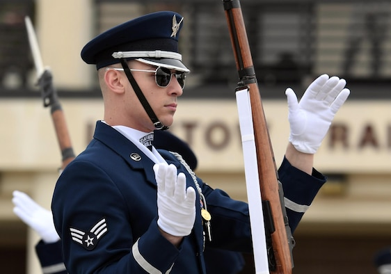 U.S. Air Force Senior Airman Nathan Leslie, U.S. Air Force Honor Guard Drill Team member, participates in the debut performance of the team's 2019 routine in front of Keesler leadership and 81st Training Group Airmen on the Levitow Training Support Facility drill pad at Keesler Air Force Base, Mississippi, Feb. 8, 2019. The team comes to Keesler every year for five weeks to develop a new routine that they will use throughout the year. (U.S. Air Force photo by Kemberly Groue)
