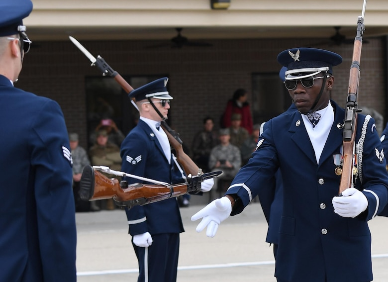 U.S. Air Force Senior Airman Colby Marshall, U.S. Air Force Honor Guard Drill Team member, participates in the debut performance of the team's 2019 routine in front of Keesler leadership and 81st Training Group Airmen on the Levitow Training Support Facility drill pad at Keesler Air Force Base, Mississippi, Feb. 8, 2019. The team comes to Keesler every year for five weeks to develop a new routine that they will use throughout the year. (U.S. Air Force photo by Kemberly Groue)