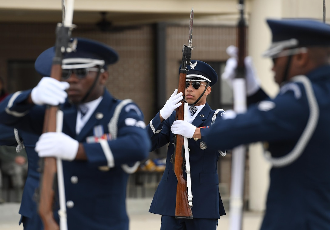 U.S. Air Force Senior Airman Bryan Satterlee, U.S. Air Force Honor Guard Drill Team member, participates in the debut performance of the team's 2019 routine in front of Keesler leadership and 81st Training Group Airmen on the Levitow Training Support Facility drill pad at Keesler Air Force Base, Mississippi, Feb. 8, 2019. The team comes to Keesler every year for five weeks to develop a new routine that they will use throughout the year. (U.S. Air Force photo by Kemberly Groue)