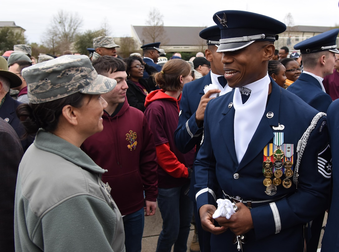 U.S. Air Force Col. Debra Lovette, 81st Training Wing commander, meets with Master Sgt. Jason Prophet, U.S. Air Force Honor Guard Drill Team superintendent, following the debut performance of their 2019 routine for Keesler leadership and 81st Training Group Airmen on the Levitow Training Support Facility drill pad at Keesler Air Force Base, Mississippi, Feb. 8, 2019. The team comes to Keesler every year for five weeks to develop a new routine that they will use throughout the year. (U.S. Air Force photo by Kemberly Groue)