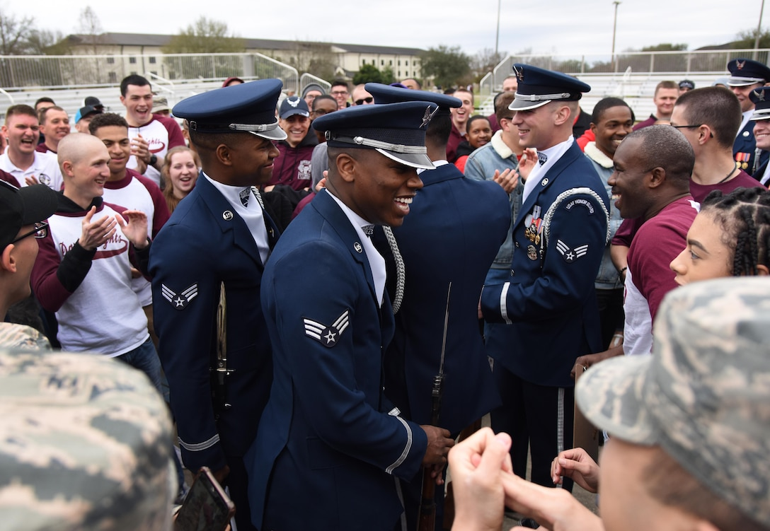 U.S. Air Force Honor Guard Drill Team members meet with Keesler leadership and 81st Training Group Airmen following the debut performance of their 2019 routine on the Levitow Training Support Facility drill pad at Keesler Air Force Base, Mississippi, Feb. 8, 2019. The team comes to Keesler every year for five weeks to develop a new routine that they will use throughout the year. (U.S. Air Force photo by Kemberly Groue)