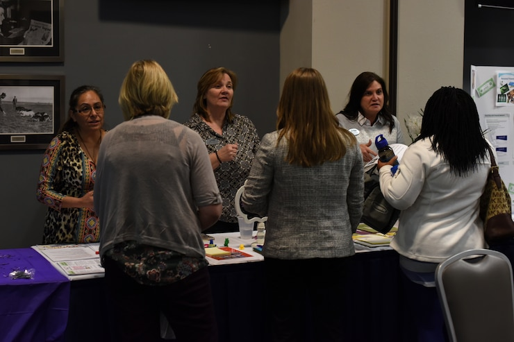 Members from 17th Force Support Squadron speak with attendees of the Key Spouses' Program All Call at the Event Center, Goodfellow Air Force Base, Texas, Feb. 7, 2019. Booths were available for anyone in attendance to ask additional questions after the question and answer portion of the night. (U.S. Air Force photo by Airman 1st Class Zachary Chapman/Released)