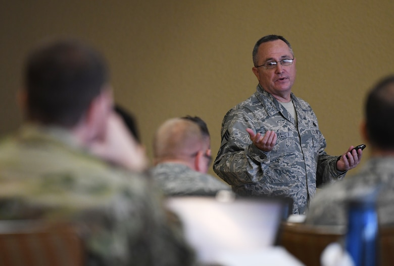 U.S. Air Force Chief Master Sgt. Robert Hill, Second Air Force training operations, briefs a group on the current training development of the command during the 2019 Career Field Managers Conference at Keesler Air Force Base, Mississippi, Feb. 7, 2019. The three-day conference, put on by the 81st Training Support Squadron, is designed to improve lines of communication between all levels of training development and delivery. This year the main topics of discussion were the blended learning approach to training, advancements in cyber training, advancing the technical training enterprise and augmented and virtual reality as training options. (U.S. Air Force photo by Master Sgt. Ryan Crane)