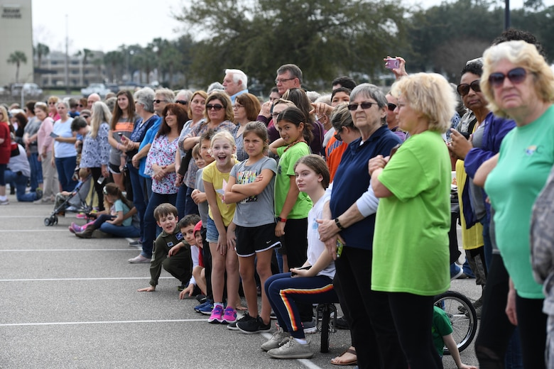 Keesler families line the base exchange parking lot to view the Budweiser Clydesdales as they make an appearance at Keesler Air Force Base, Mississippi, Feb. 7, 2019. They made their first appearance in 1933 and have been featured prominently in two presidential inaugurations. The Keesler Base Exchange hosted the event for Airmen and their families to enjoy. (U.S. Air Force photo by Kemberly Groue)