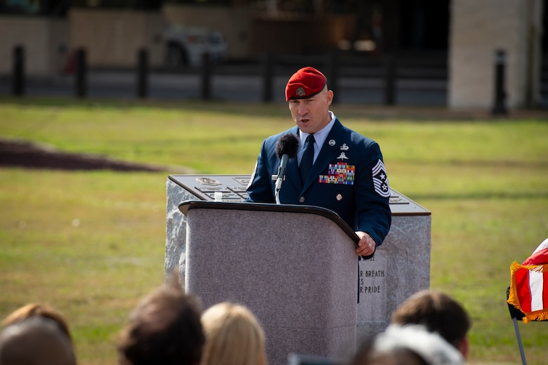 U.S. Air Force Chief Master Sgt. Jeff Guilmain, command chief of the 24th Special Operations Wing, narrates the promotion ceremony of U.S. Air Force Col. Claude K. Tudor, Jr., at Hurlburt Field, Florida, Feb. 8, 2019.