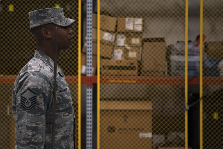 U.S. Air Force Master Sgt. Jason Prophet, Air Force Honor Guard Drill Team superintendent, gives a command during drill team practice inside the Roberts Consolidated Aircraft Maintenance Facility at Keesler Air Force Base, Mississippi, Jan. 30, 2019. The Air Force Honor Guard spends five weeks at Keesler perfecting their routine they are going to use for the rest of the year. (U.S. Air Force photo by Airman 1st Class Suzie Plotnikov)