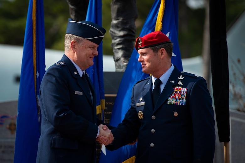U.S. Air Force Lt. Gen. Brad Webb, left, commander of Air Force Special Operations Command, congratulates U.S. Air Force Brig. Gen. Claude K. Tudor, Jr., commander of the 24th Special Operations Wing, during a ceremony at Hurlburt Field, Florida, Feb. 8, 2019.