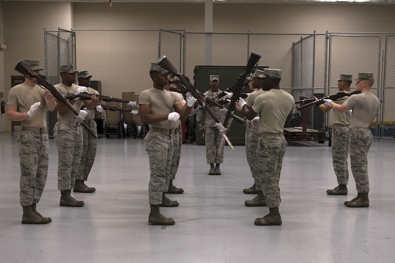 U.S. Air Force Honor Guard members practice their new routine inside the Roberts Consolidaated Aircraft Maintenance Facility at Keesler Air Force Base, Mississippi, Jan. 30, 2019. The Air Force Honor Guard spends five weeks at Keesler perfecting their routine they are going to use for the rest of the year. (U.S. Air Force photo by Airman 1st Class Suzie Plotnikov)