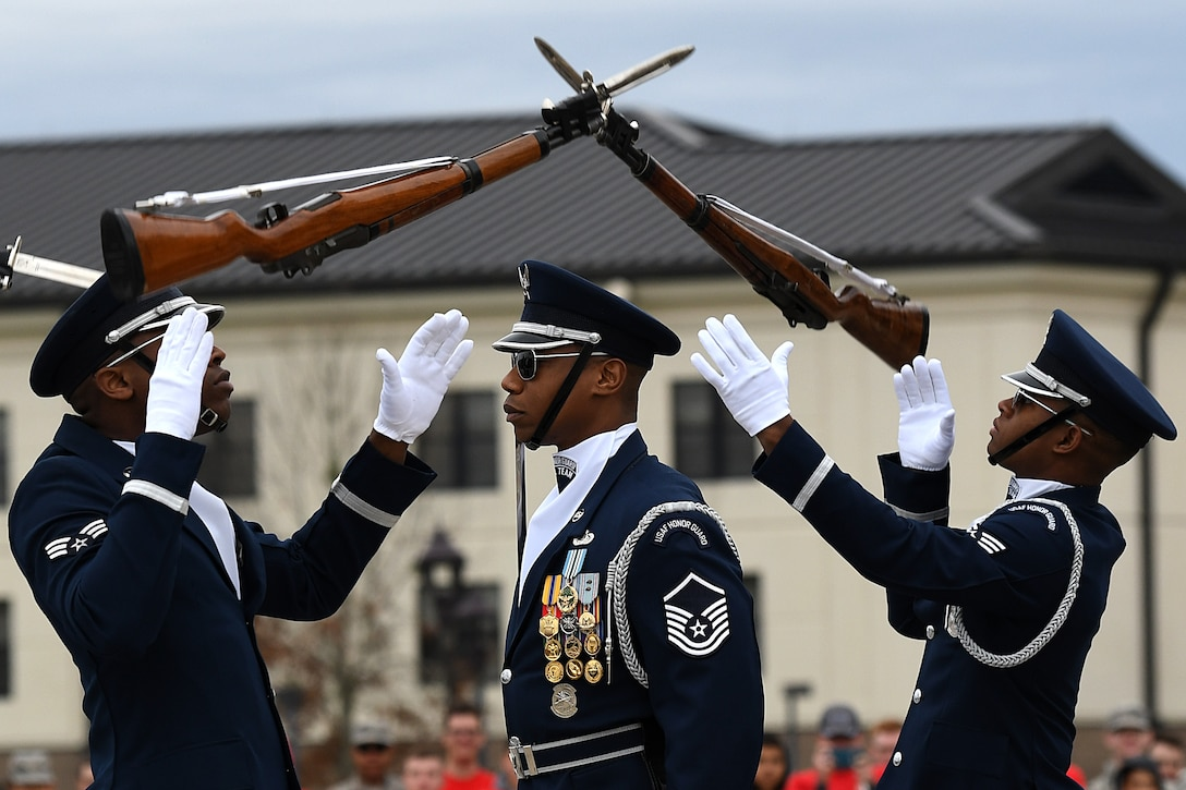U.S. Air Force Senior Airman Bryan Satterlee, U.S. Air Force Honor Guard Drill Team member, Master Sgt. Jason Prophet, U.S. Air Force Honor Guard Drill Team superintendent, and Senior Airman Darren Lawrence, U.S. Air Force Honor Guard Drill Team member, participate in the debut of their 2019 routine in front of Keesler leadership and 81st Training Group Airmen on the Levitow Training Support Facility drill pad at Keesler Air Force Base, Mississippi, Feb. 8, 2019. The team comes to Keesler every year for five weeks to develop a new routine that they will use throughout the year. (U.S. Air Force photo by Airman 1st Class Suzie Plotnikov)