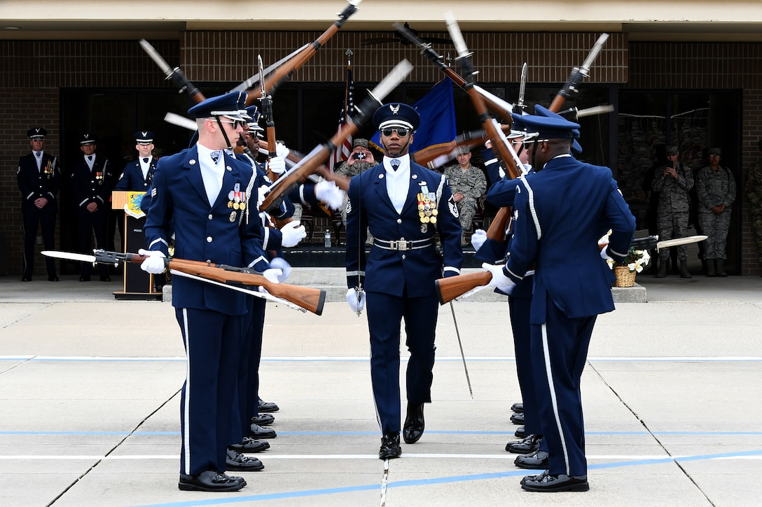 The U.S. Air Force Honor Guard Drill Team debuts their 2019 routine in front of Keesler leadership and 81st Training Group Airmen on the Levitow Training Support Facility drill pad at Keesler Air Force Base, Mississippi, Feb. 8, 2019. The team comes to Keesler every year for five weeks to develop a new routine that they will use throughout the year. (U.S. Air Force photo by Airman 1st Class Suzie Plotnikov)