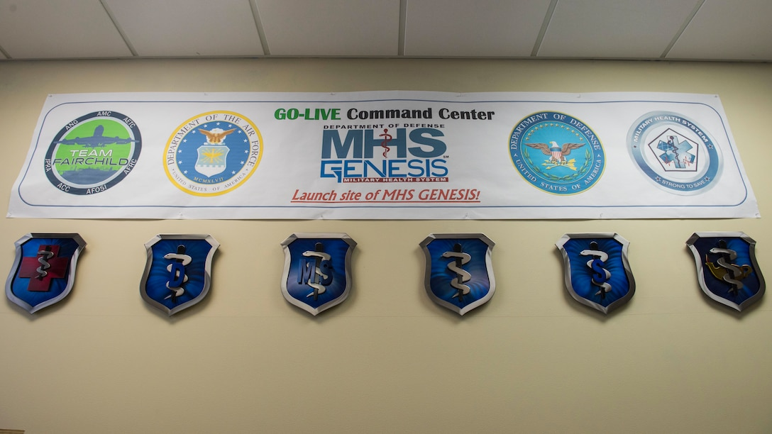 A banner marking Fairchild's 92nd Medical Group as an initial testing site for Military Health System Genesis hangs on the wall during the celebration of the second year anniversary MHS Genesis' implementation at Fairchild Air Force Base, Washington, Feb. 8, 2019. Fairchild's 92nd MDG was selected as the first Department of Defense medical clinic to launch this $11 billion electronic health record system and has successfully used the program since Feb. 7, 2017. (U.S. Air Force photo/Airman 1st Class Lawrence Sena)