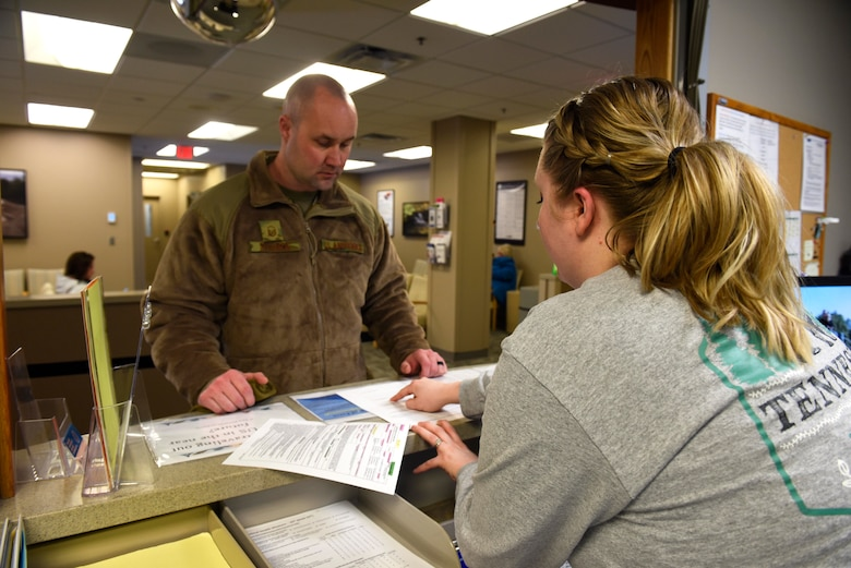 Taylor Kobylinski, 92nd Medical Operation Squadron medical administration assistant, assists an Airman with checking-in to the Family Health Center at Fairchild Air Force Base, Washington, Feb. 8, 2019. Data shows that initial fielding sites, like Fairchild, that document patient care in MHS Genesis continue to show increased operating capabilities in areas such as referrals processed, patients seen, prescriptions filled, and secure messaging. (U.S. Air Force photo/Airman 1st Class Lawrence Sena)