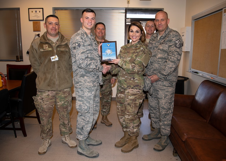 U.S. Air Force Senior Airman Kendell Carver, 377th Maintenance Squadron, receives the January Diamond Sharp award from TSgt. Robbie Powell-Greenwood, 377 MXS acting first sergeant, at Kirtland Air Force Base, N.M., Feb. 6, 2019. (U.S. Air Force photo by Staff Sgt. Kimberly Nagle)