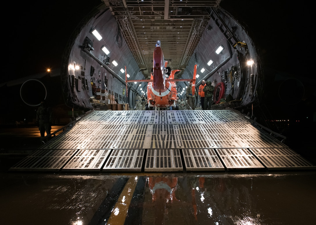 Port Dawgs load MH-65D Dolphin helicopter
