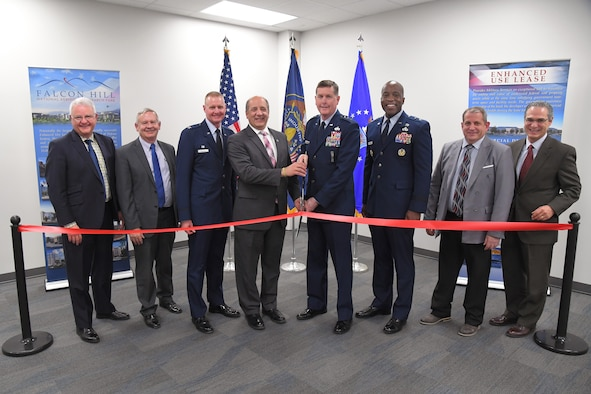 (Left to right) Randall Woodbury, Woodbury Corporation president, Dave Williamsen, Enhanced Use Lease program manager, Col. Jon Eberlan, 75th Air Base Wing commander, Gary Harter, Utah Department of Veterans and Military Affairs executive director, Lt. Gen. Gene Kirkland, Air Force Sustainment Center commander, Maj. Gen. Stacy Hawkins, Ogden Air Logistics Complex commander, Jim Diamond, 309th Software Maintenance Group director, and Juan Gonazales-Garza, Hunt Companies Inc. vice president of development, cut a ribbon during a ceremony Feb. 8, 2019, celebrating the opening of a new 309th Software Maintenance Group support facility at Hill Air Force Base, Utah. The $35 million facility has 15,300 square feet of laboratory space and will accommodate an anticipated growth of around 1,600 personnel currently to more than 3,000 personnel over the next decade. Construction of the facility was funded in part by the Utah state legislature that appropriated $21.5 million. (U.S. Air Force photo by Todd Cromar)