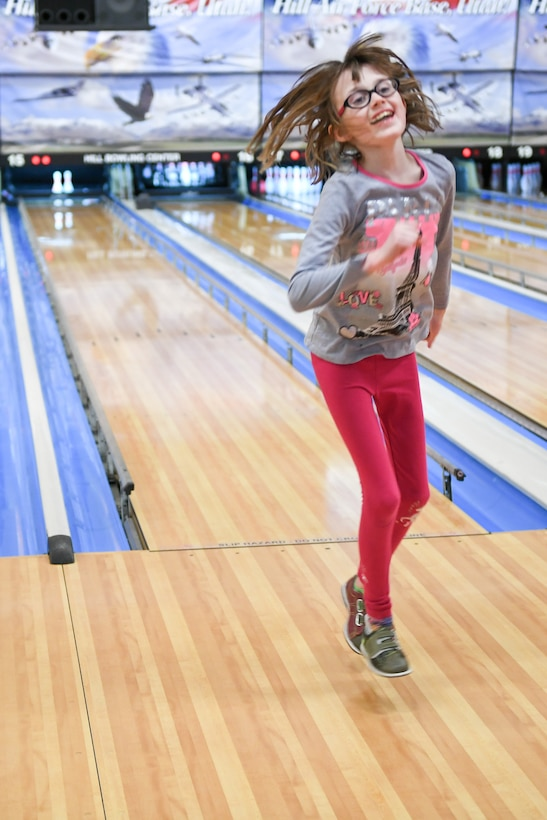 Hailey Cook jumps while bowling Jan. 30, 2019, at the event held by Exceptional Family Member Program-Family Support at Hill Air Force Base, Utah. (U.S. Air Force photo by Cynthia Griggs)