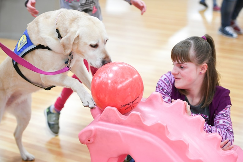 Brianna Heim watches her service dog, Emily, as she bowls Jan. 30, 2019, at the bowling event held by Exceptional Family Member Program-Family Support at Hill Air Force Base, Utah. (U.S. Air Force photo by Cynthia Griggs)