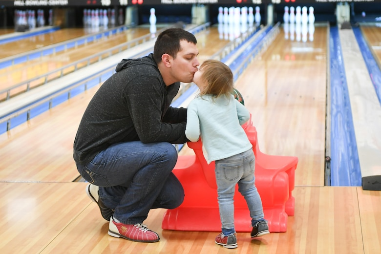 Airman Matthew Carvajal shares a moment with his daughter Ella before she bowls Jan. 30, 2019, at the bowling event held by Exceptional Family Member Program-Family Support at Hill Air Force Base, Utah. (U.S. Air Force photo by Cynthia Griggs)