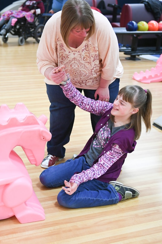 0261 Wendy and Brianna Heim hi-five each other during bowling Jan. 30, 2019, at the event held by Exceptional Family Member Program-Family Support at Hill Air Force Base, Utah. (U.S. Air Force photo by Cynthia Griggs)
