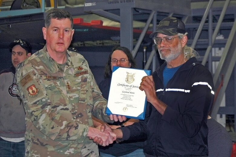 Gayland D. Rentie, 573rd Aircraft Maintenance Squadron, receives a 40-year certificate of service from Lt. Gen Gene Kirkland, Air Force Sustainment Center commander, Feb. 4, 2019, at Hill Air Force Base, Utah. (U.S. Air Force photo by Donovan Potter)