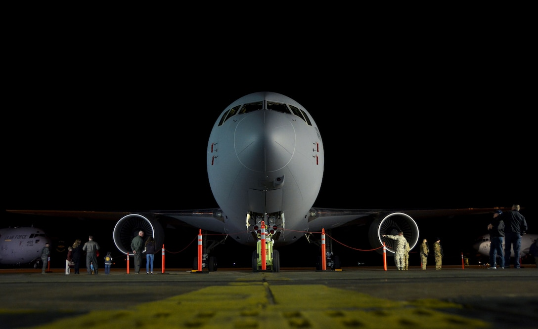 The KC-46A Pegasus looms over the flightline at Altus Air Force Base, Oklahoma, Feb. 8, 2019, shortly after its historic delivery. Reservists in the 730th Air Mobility Training Squadron are charged with training aircrew on the newest aerial refueling aircraft alongside their active duty counterparts in the 97th Air Mobility Wing. (U.S. Air Force photo by Tech. Sgt. Samantha Mathison)