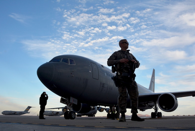A 97th Air Mobility Wing security forces defender guards a KC-46A Pegasus during post-flight checks at Altus Air Force Base, Oklahoma, Feb. 8, 2019. The 730th Air Mobility Training Squadron, which falls under AFRC's 507th Air Refueling Wing at Tinker AFB, Oklahoma, is an associate unit that merges with active duty Airmen in the 97th AMW to accomplish aircrew training.(U.S. Air Force photo by Tech. Sgt. Samantha Mathison)
