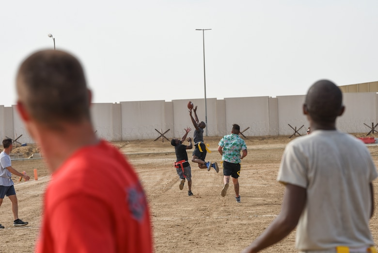 Members assigned to Al Dhafra Air Base, United Arab Emirates, participate in an intramural football tournament game, Nov. 11, 2018. The 380th Expeditionary Force Support Squadron Fitness Center Staff hosts intramural sporting including softball, football and basketball, for ADAB personnel to remain fit to fight while having fun. (U.S. Air Force photo by Tech. Sgt. Darnell T. Cannady)