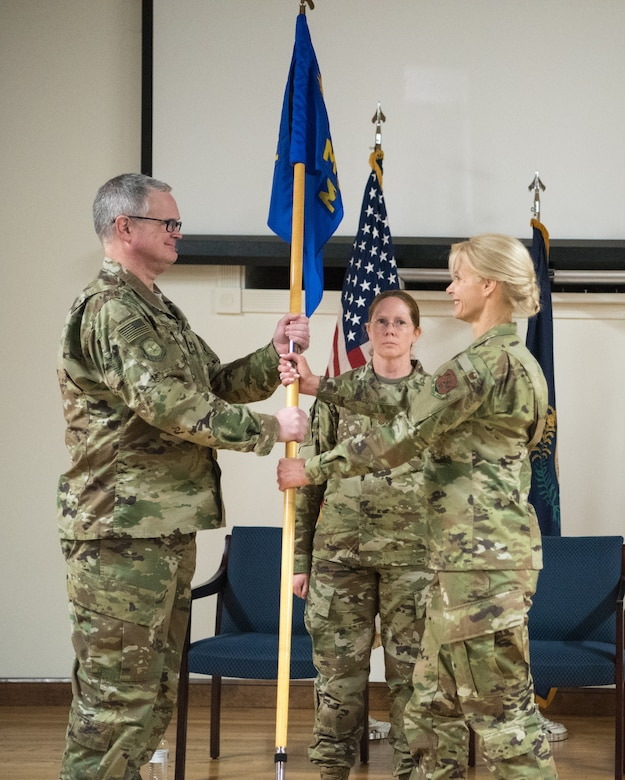Col. Mary Decker (right) assumes command of the 123rd Mission Support Group as she accepts the unit's guidon from Col. David Mounkes, commander of the 123rd Airlift Wing, during a change-of-command ceremony at the Kentucky Air National Guard base in Louisville, Ky., Jan. 5, 2019. Decker replaces Col. Patrick Pritchard, who has been named vice commander of the 123rd Airlift Wing. (U.S. Air National Guard photo by Master Sgt. Phil Speck)