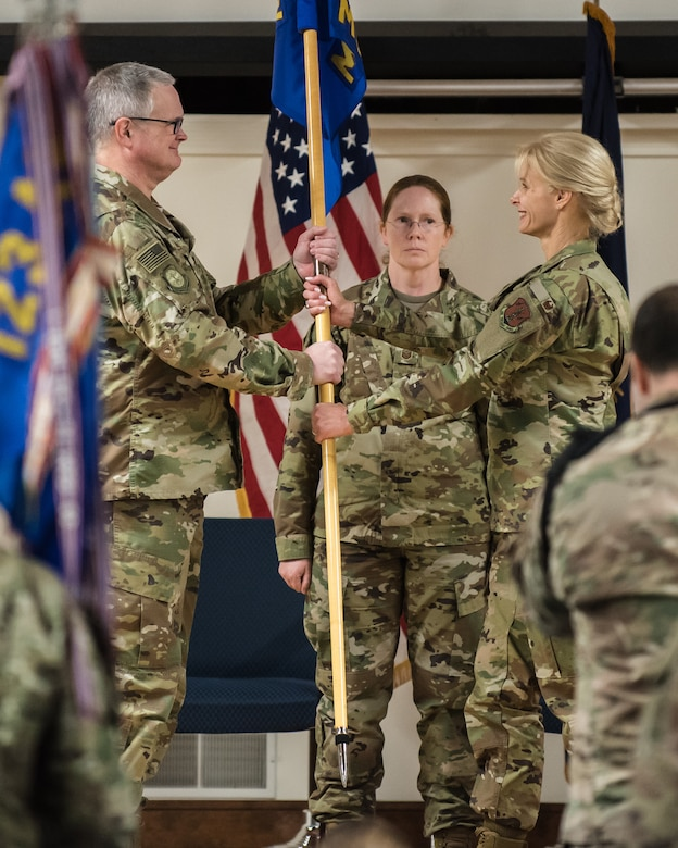Col. Mary Decker accepts the 123rd Mission Support Group guidon from Col. David Mounkes, commander of the 123rd Airlift Wing, as she assumes command of the group during a ceremony at the Kentucky Air National Guard Base in Louisville, Ky., Jan. 5, 2019. Decker replaces Col. Patrick Pritchard, who has been named vice commander of the 123rd Airlift Wing. (U.S. Air National Guard photo by Dale Greer)