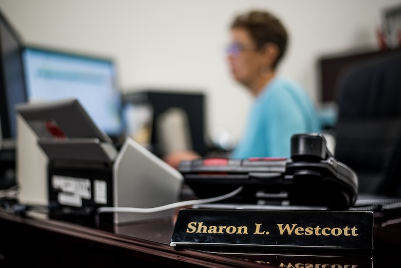Sharon L. Westcott, 512th Maintenance Group commander's secretary, works at her station at Dover Air Force Base, Delaware, Feb. 1, 2019. Westcott has worked in the Department of Defense for 37 years, assisting and helping develop more than 30 senior leaders. (U.S. Air Force photo by Staff Sgt. Damien Taylor)