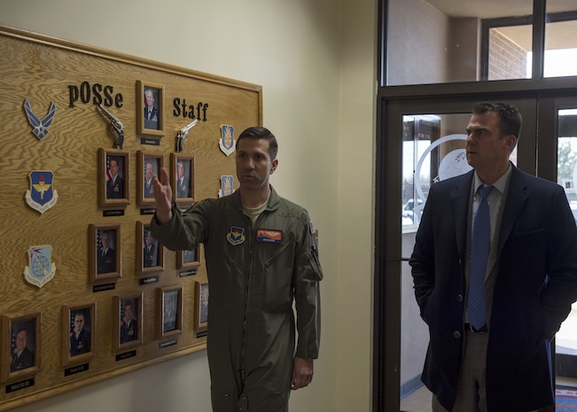 Maj. Ben Shaub, director of operations for the 97th Operations Support Squadron, shows Oklahoma State Governor Kevin Stitt the OSS main building, Feb. 8, 2019, at Altus Air Force Base, Okla. Stitt received a small tour of the building before speaking with Airmen from the 97th Air Mobility Wing. (U.S. Air Force Photo by Senior Airman Jackson N. Haddon)