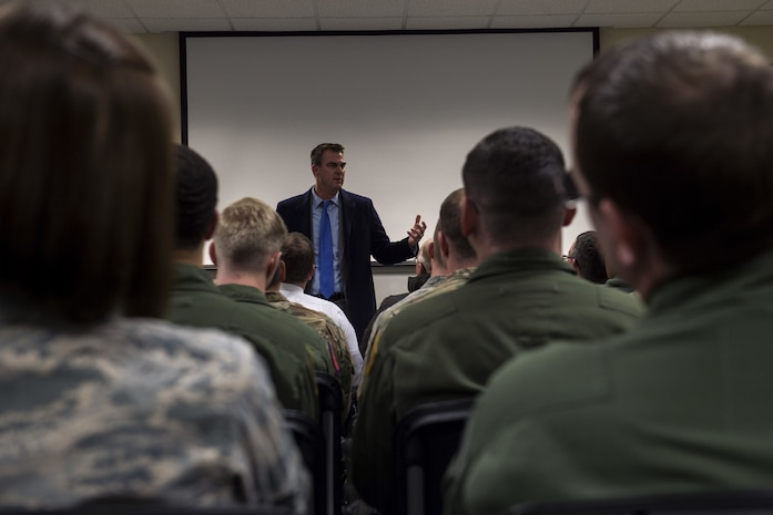 Oklahoma State Governor Kevin Stitt speaks to Airmen from the 97th Air Mobility Wing, Feb. 8, 2019, at Altus Air Force Base, Okla. Stitt spoke to the Airmen about his challenges and goals as Governor of Oklahoma and the similarities between the military and politics. (U.S. Air Force Photo by Senior Airman Jackson N. Haddon)