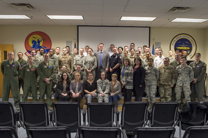 Members from the 97th Air Mobility Wing pose for a photo with Oklahoma State Governor Kevin Stitt, Feb. 8, 2019, at Altus Air Force Base, Okla. Stitt arrived early for the KC-46A Pegasus arrival celebration in order to visit with the Airmen. (U.S. Air Force Photo by Senior Airman Jackson N. Haddon)