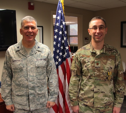 "At left, Chaplain (Lt. Col.) Thornton shares a smile as he presents the Air Force Commendation Medal to Chaplain (Maj.) Michael Williams, for Meritorious Service in a special ceremony held Feb. 9, 2019, at Scott Air Force Base, Illinois.  The medal and certificate recognized Chaplain Williams work over a long multi-year period starting in September 2012.  The 932nd AW Chapel Corps of chaplains and chaplain assistants, referred to as Religious Support Teams (RST), have the privilege of focusing on caring for unit members and their families throughout the deployment cycle and beyond. Unit visits and personal engagements are a part of this warrior care. ""The 932nd AW team provide proactive pastoral care as well as religious accommodations that meet diverse spiritual needs, in order to foster the spiritual pillar of Comprehensive Airman Fitness within the Wing,"" said Chaplain Thornton, who also retires today."