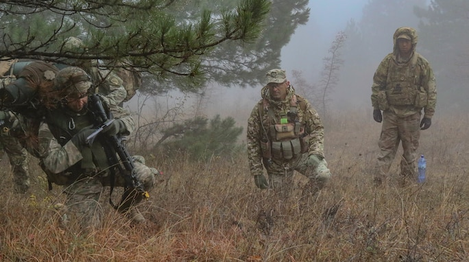 Georgian Army Maj. Bacho Ghakaria (center) and U.S. Army 1st Lt. Russyl Soto (right), observer controllers during a Combat Training Center rotation, assess the performance of a Georgian Army soldier with the 32nd Infantry Battalion at Norio Training Area, Georgia, Nov. 13, 2018.