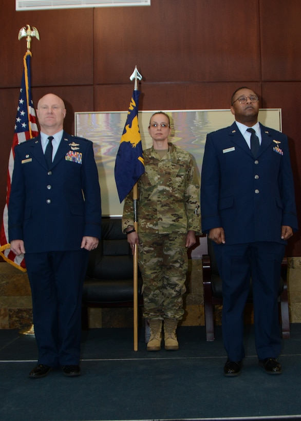 Lt. Col. (Dr.) Alvin Bradford stands ready to accept the guideon from the 507th Air Refueling Wing Commander, Col. Miles Heaslip, during the 507th Medical Squadron assumption of command ceremony at Tinker Air Force Base, Oklahoma, Feb. 9, 2019. Prior to assuming command, Bradford served as the Chief of Aerospace Medicine in the 507th MDS. (U.S. Air Force photo by Master Sgt. Grady Epperly)