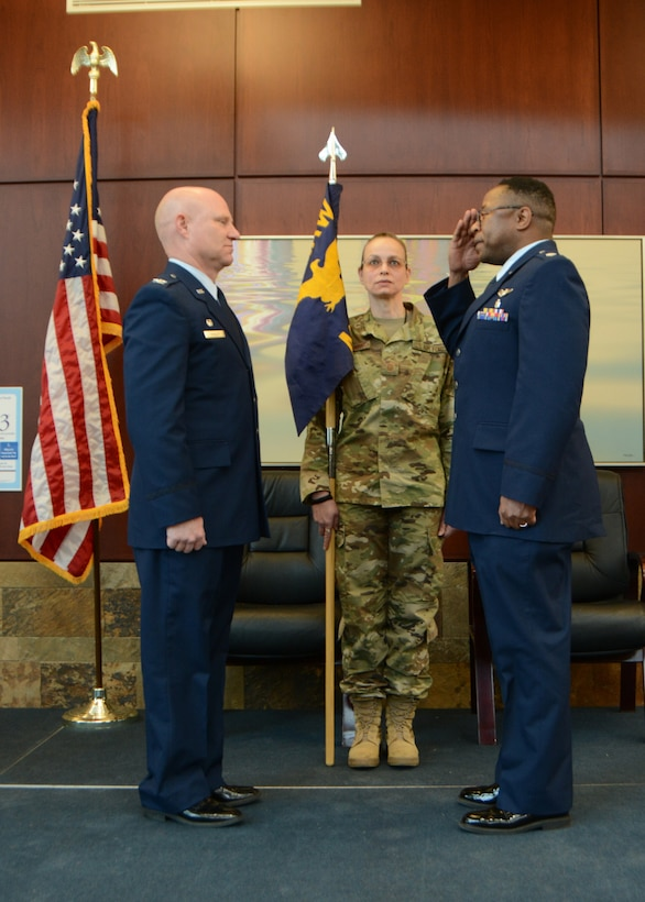 Lt. Col. (Dr.) Alvin Bradford salutes the 507th Air Refueling Wing Commander, Col. Miles Heaslip, as Bradford assumes command of the 507th Medical Squadron at Tinker Air Force Base, Oklahoma, Feb. 9, 2019. Prior to assuming command, Bradford had been the Chief of Aerospace Medicine in the 507th MDS. (U.S. Air Force photo by Master Sgt. Grady Epperly)