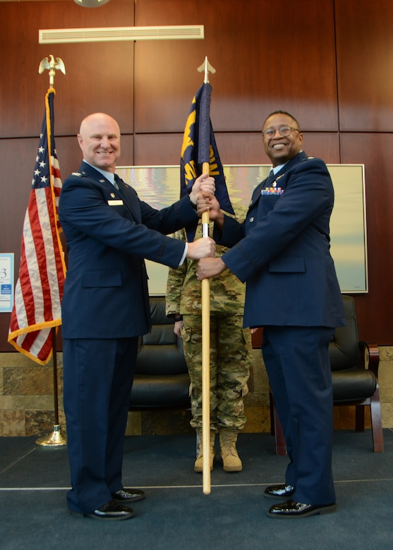 Lt. Col. (Dr.) Alvin Bradford accepts the guideon from the 507th Air Refueling Wing Commander, Col. Miles Heaslip, during the 507th Medical Squadron assumption of command ceremony at Tinker Air Force Base, Oklahoma, Feb. 9, 2019. Prior to assuming command, Bradford served as the Chief of Aerospace Medicine in the 507th MDS. (U.S. Air Force photo by Master Sgt. Grady Epperly)
