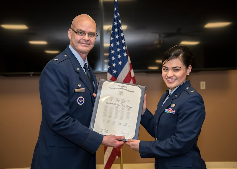 Lieutenant Colonel Mark Guerber, detachment commander for University of Massachusetts in Amherst Reserve Officer Training Corps Detachment 370, and 2nd Lt. Nicolle Mathison pose for a photo Feb. 7, 2018, at Barnes Air National Guard Base. Mathison will serve as a public affairs officer at Nellis Air Force Base. (U.S. Air National Guard photo by Airman 1st Class Randy Burlingame)