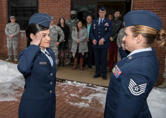 Second Lieutenant Nicolle Mathison salutes Tech. Sgt. Tanya Sweeney, 104th Force Support Squadron dining facility NCO in charge, Feb. 7, 2018, at Barnes Air National Guard Base. The first salute is a time honored tradition where a newly commissioned officer salutes somebody that has had an impact on them. (U.S. Air National Guard photo by Airman 1st Class Randy Burlingame)